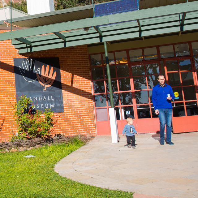Man and child standing outside Randall Museum