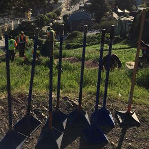 Gardening tools on a hill overlooking town