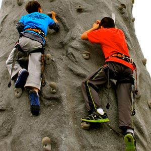 Two youths on a climbing wall