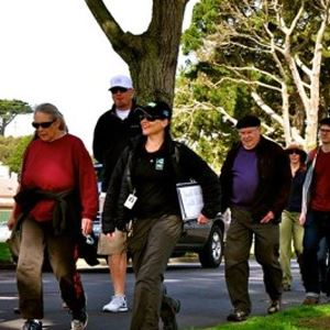 Group walking on a paved trail