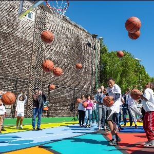 People with basketballs on Hayes Valley Court