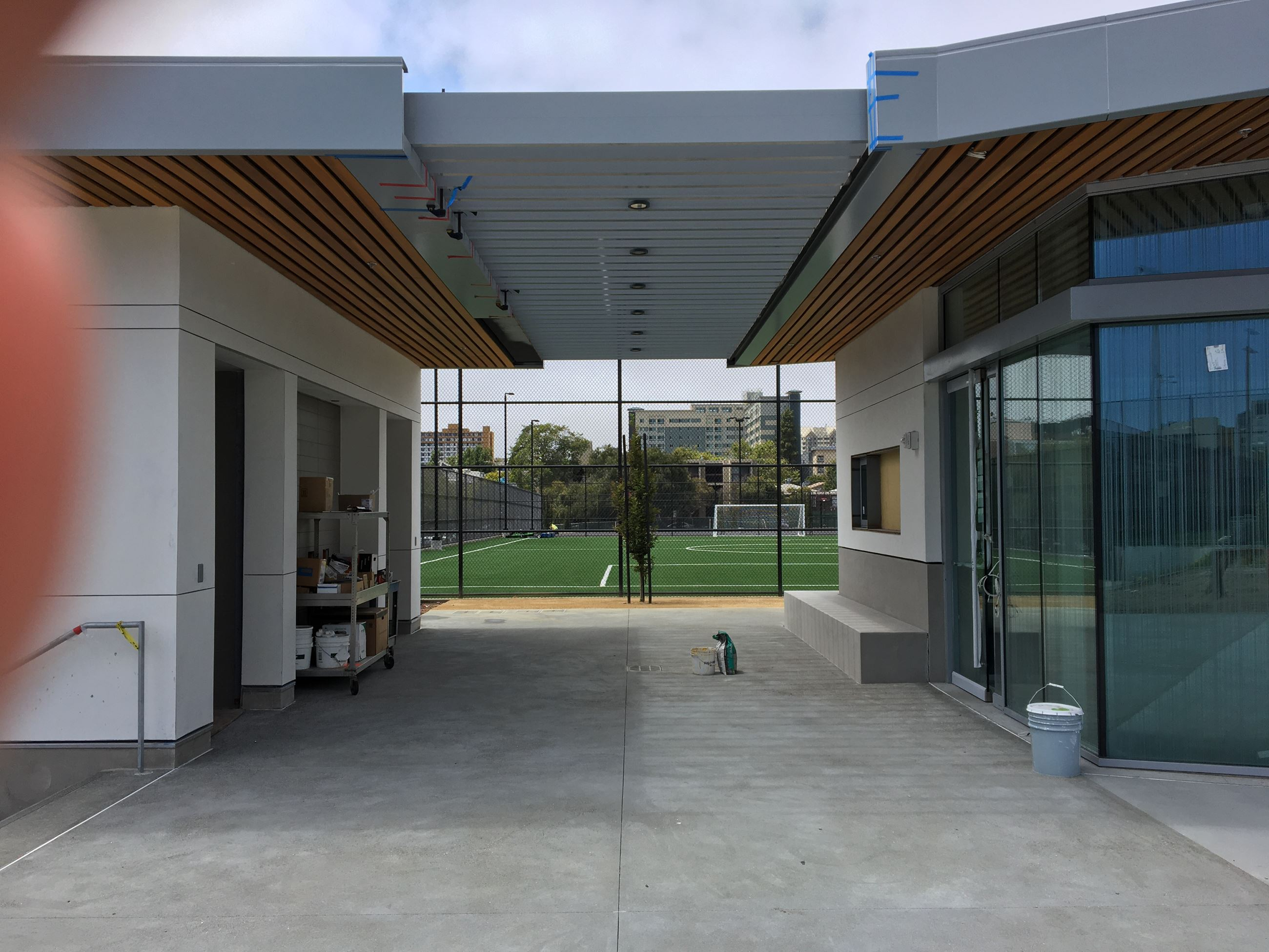 Foyer of the clubhouse with glass wall entrance on the right, covered in between restroom area,